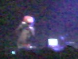 That is the red helmet on the singer, the light blobs are his hands.